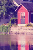 Porvoo, Finland. Old wooden red houses on the riverside with instagram effect retro vintage filter Royalty Free Stock Images