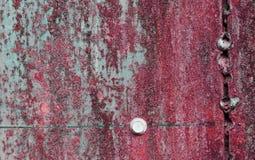 Porysowana i ośniedziała czerwona metal powierzchnia Fotografia Stock