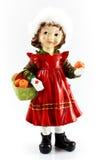 Porzellanmädchen mit Äpfeln Stockfoto