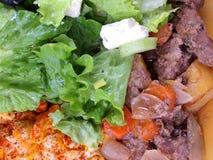 Porzione di alimento fotografie stock