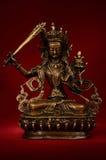 Posążek wymachuje kordzika mądrość na czerwieni z powrotem Manjushri Zdjęcie Stock