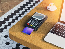 POS Credit card machine on wooden table. 3d rendering Royalty Free Stock Images