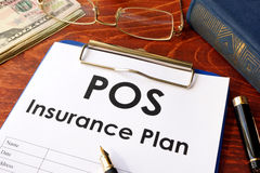 POS Insurance Plan on a table. Royalty Free Stock Photography