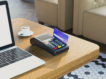 POS portable credit card machine with credit card on wooden table. 3d rendering Royalty Free Stock Photography