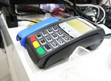 POS terminal on the table. Close-up. Royalty Free Stock Photo