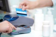 POS Terminal Transaction. Hand Swiping a Credit Card. Stock Photo