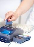 POS Terminal Transaction. Hand Swiping a Credit Card. Stock Photos