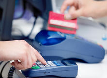 POS Terminal Transaction. Hand Swiping a Credit Card. Stock Image
