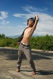Posa asiatica di modo del ragazzo all'aperto Fotografia Stock Libera da Diritti