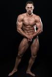 Posa bella di Making Most Muscular del costruttore di corpo immagine stock libera da diritti