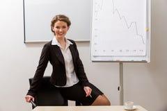Posa della donna di affari Immagine Stock