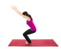 Posa della sedia o posa potente nell'yoga Immagini Stock