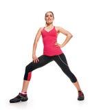 Posa relativa alla ginnastica di forma fisica della donna Immagini Stock