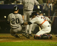 Posada beats the throw. Catcher Jorge Posada slides safely into home plater scoring the go ahead run in Game 5 of the 2000 World Series. (Image taken from color royalty free stock images