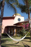 Posada mexicana -Mexico. Mexican house with colorful plants and a hammock in the front Royalty Free Stock Photography
