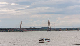 Posadas Argentina. The shore of Parana river with a boat and the bridge Stock Photos
