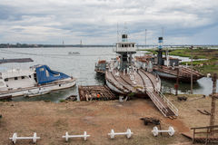 Posadas Argentina. The shore of Parana river with boats and the bridge. Posadas, Argentina stock image