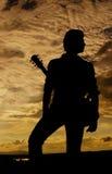 Posando con la chitarra Fotografie Stock