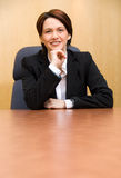 The pose. Happy business woman in a boardroom table stock photo