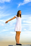 Pose. A girl stands on the roof of a skyscraper Royalty Free Stock Photo