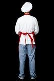 Pose arrière d'un chef masculin dans l'uniforme photo stock