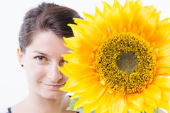 Pose behind a sunflower Stock Photo