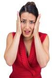 Pose d'une chevelure attachée craintive de brune Images stock
