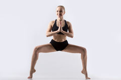 Pose de posture accroupie de sumo Photos libres de droits