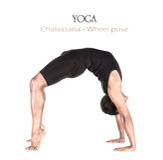 Pose de roue de Chakrasana de yoga Photographie stock