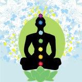 Pose dos lótus da IOGA Padmasana com pontos coloridos do chakra Fotografia de Stock Royalty Free
