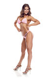 Pose du concurrent de forme physique de bikini de femme images libres de droits