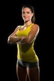 Pose forte d'athlète de champion de femme d'entraîneur physique puissant féminin sûr en sueur déterminé intense de combattant Photo libre de droits