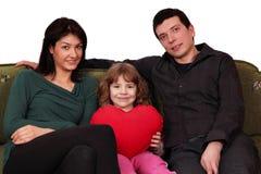 Pose heureuse de famille Photographie stock libre de droits