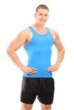 Pose musculaire de jeune homme image stock