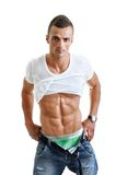 Pose musculaire puissante d'homme image stock