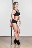 Pose sexy de danseur de poteau Photos libres de droits