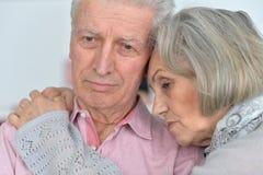 Pose supérieure triste de couples Image stock