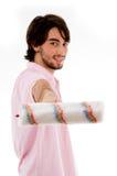 Pose traseiro do homem com rolo de pintura Fotografia de Stock Royalty Free