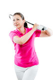 Pose woman golfer after hitting a ball club on a white Stock Photo