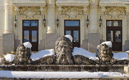 Poseidon Fountain well. Artesian Fountain coverd by snow representing Poseidon in front of baroque style building Stock Photography