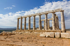 Poseidon temple, Sounio, Greece. Cape Sounio is noted as the site of ruins of an ancient Greek temple of Poseidon, the god of the sea in classical mythology. The stock photo