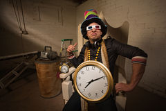 Poser in Large Hat and Clock Stock Photos