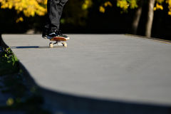Poser. Person riding a skateboard at the skateboard park Stock Photography