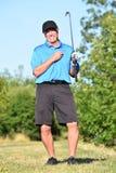 Posera den idrotts- mannen för manlig golfare med Golf Club royaltyfri foto