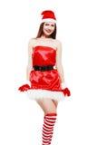 Posera för julflicka Arkivfoton