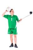 Posera för sportswear för mogen man iklätt grönt Fotografering för Bildbyråer