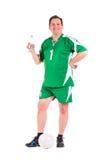 Posera för sportswear för mogen man iklätt grönt Arkivbild