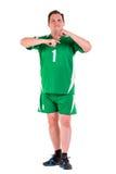 Posera för sportswear för mogen man iklätt grönt Royaltyfri Fotografi