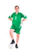 Posera för sportswear för mogen man iklätt grönt Arkivfoton