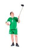 Posera för sportswear för mogen man iklätt grönt Royaltyfri Bild
